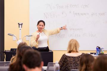 Professor of Practice Mara Force leads a class in the Goldring/Woldenberg Business Complex
