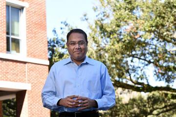 Venkat Subramaniam photographed outside the Goldring/Woldenberg Business Complex